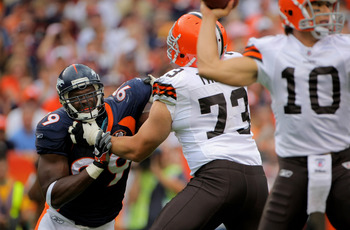 DENVER - SEPTEMBER 20:  Defensive end Vonnie Holliday #99 of the Denver Broncos battles the block of offensive lineman Joe Thomas #73 of the Cleveland Browns as he rushes quarterback Brady Quinn #10 during NFL action at Invesco Field at Mile High on Septe