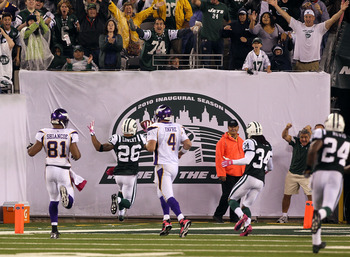 EAST RUTHERFORD, NJ - OCTOBER 11: Dwight Lowery #26 of the New York Jets scores a 26-yard interception return for a touchdown in the fourth quarter against Brett Favre #4 of the Minnesota Vikings at New Meadowlands Stadium on October 11, 2010 in East Ruth
