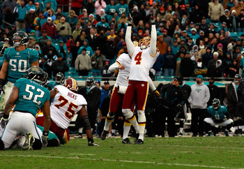 JACKSONVILLE, FL - DECEMBER 26:  Kicker Graham Gano #4 of the Washington Redskins celebrates after kicking the winning field goal in overtime during the game against the Jacksonville Jaguars at EverBank Field on December 26, 2010 in Jacksonville, Florida.