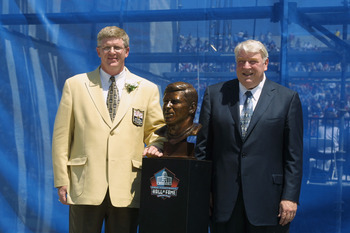CANTON, OHIO - AUGUST 3:  Dave Casper (left) stands next to his bust with his presenter and former head coach John Madden after his induction into the National Football League Hall of Fame on August 3, 2002 at Fawcett Stadium in Canton, Ohio.  Dave Casper