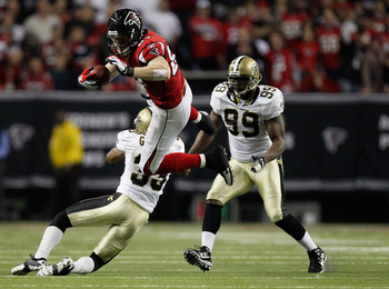 ATLANTA, GA - DECEMBER 27:  Justin Peelle #87 of the Atlanta Falcons goes up and over the tackle of Jabari Greer #33 of the New Orleans Saints during their game at the Georgia Dome on December 27, 2010 in Atlanta, Georgia.  (Photo by Kevin C. Cox/Getty Im