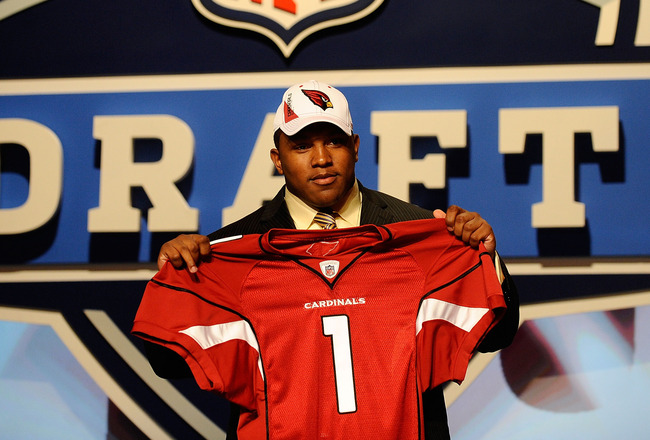 NEW YORK - APRIL 22:  Dan Williams from the Tennessee Volunteers holds up a Arizona Carinals jersey after he was selected number 26 overall by the Cardinals during the first round of the 2010 NFL Draft at Radio City Music Hall on April 22, 2010 in New Yor