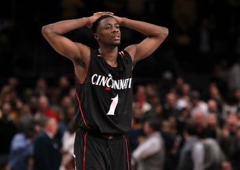 NEW YORK - MARCH 11: Cashmere Wright #1 of the Cincinnati Bearcats reacts late in the game against the West Virginia Mountaineers during the quarterfinal of the 2010 NCAA Big East Tournament at Madison Square Garden on March 11, 2010 in New York City.  (P