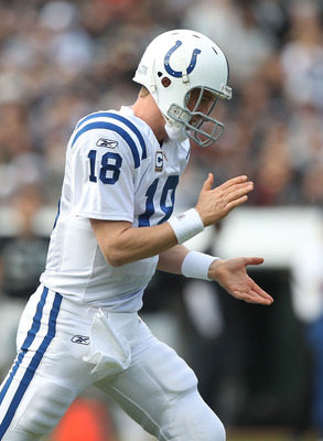 OAKLAND, CA - DECEMBER 26:  Peyton Manning #18 of the Indianapolis Colts celebrates after a Joseph Addai touchdown against the Oakland Raiders during an NFL game at Oakland-Alameda County Coliseum on December  26, 2010 in Oakland, California.  (Photo by J