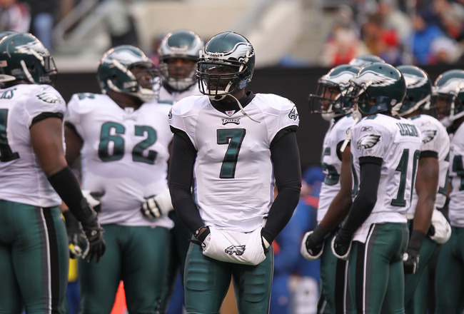 EAST RUTHERFORD, NJ - DECEMBER 19:  Michael Vick #7 of the Philadelphia Eagles stands by the huddle against the New York Giants at New Meadowlands Stadium on December 19, 2010 in East Rutherford, New Jersey.  (Photo by Nick Laham/Getty Images)