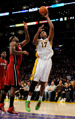 LOS ANGELES, CA - DECEMBER 25:  Andrew Bynum #17 of the Los Angeles Lakers puts a shot up against Erick Dampier #25 of the Miami Heat at Staples Center on December 25, 2010 in Los Angeles, California. NOTE TO USER: User expressly acknowledges and agrees t