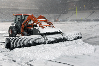 PHILADELPHIA - DECEMBER 26: A plow works to remove snow from the playing surface at Lincoln Financial Field on December 26, 2010 in Philadelphia, Pennsylvania. The game between the Minnesota Vikings and Philadelphia Eagles was postponed by the NFL.(Photo