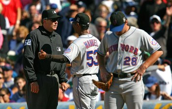 CHICAGO - AUGUST 30: Manager Jerry Manuel #53 of the New York Mets argues with first base umpire Bill Welke #52 as Daniel Murphy #28 waits during a game against the Chicago Cubs on August 30, 2009 at Wrigley Field in Chicago, Illinois. The Mets defeated t