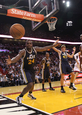 MIAMI - NOVEMBER 09:  Paul Millsap #24 of the Utah Jazz tries to stop a ball from going out of bounds during a game against the Miami Heat at American Airlines Arena on November 9, 2010 in Miami, Florida. NOTE TO USER: User expressly acknowledges and agre