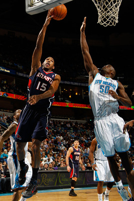 NEW ORLEANS, LA - DECEMBER 26:  Al Horford #15 of the Atlanta Hawks shoots the ball over Emeka Okafor #50 of the New Orleans Hornets at the New Orleans Arena on December 26, 2010 in New Orleans, Louisiana.  The Hornets defeated the Hawks 93-86.  NOTE TO U
