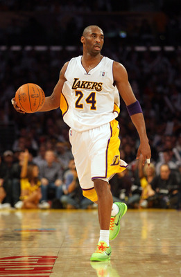 LOS ANGELES, CA - DECEMBER 25:  Kobe Bryant #24 of the Los Angeles Lakers dribbles the ball against the Miami Heat during the NBA game at Staples Center on December 25, 2010 in Los Angeles, California. NOTE TO USER: User expressly acknowledges and agrees