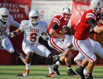 LINCOLN, NE - OCTOBER 16: Quarterback Taylor Martinez #3 of the Nebraska Cornhuskers gets the ball knocked loose by cornerback Aaron Williams #4 of the Texas Longhorns during their game at Memorial Stadium on October 16, 2010 in Lincoln, Nebraska. Texas D