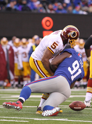 EAST RUTHERFORD, NJ - DECEMBER 05:  Justin Tuck #91 of the New York Giants sacks Donovan McNabb #5 of the Washington Redskins who fumbles and loses the ball during their game on December 5, 2010 at The New Meadowlands Stadium in East Rutherford, New Jerse
