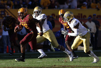 TEMPE, AZ - NOVEMBER 26:  Runningback Cameron Marshall #26 of the Arizona State Sun Devils carries the football for a 71 yard rushing touchdown past Ryan Sublett #10 and Rahim Moore #3 of the UCLA Bruins during the thrid quarter of the college football ga