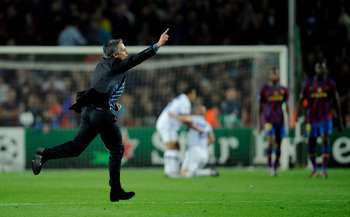 BARCELONA, SPAIN - APRIL 28: Inter Milan manager Jose Mourinho celebrates on the final whistle after the UEFA Champions League Semi Final Second Leg match between Barcelona and Inter Milan at Camp Nou on April 28, 2010 in Barcelona, Spain.  (Photo by Mich
