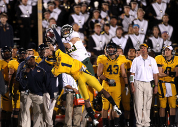 BERKELEY, CA - NOVEMBER 13:  Jeff Maehl #23 of the Oregon Ducks jumps over Steve Williams #1 of the California Golden Bears to catch the ball in front of the Cal sideline at California Memorial Stadium on November 13, 2010 in Berkeley, California. The cat