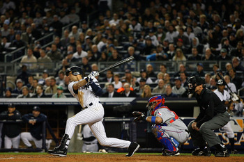 NEW YORK - OCTOBER 19:  Derek Jeter #2 of the New York Yankees hits a double in the fifth inning against the Texas Rangers in Game Four of the ALCS during the 2010 MLB Playoffs at Yankee Stadium on October 19, 2010 in the Bronx borough of New York City.