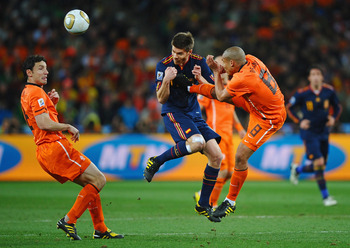 JOHANNESBURG, SOUTH AFRICA - JULY 11: Nigel De Jong of the Netherlands tackles Xabi Alonso of Spain during the 2010 FIFA World Cup South Africa Final match between Netherlands and Spain at Soccer City Stadium on July 11, 2010 in Johannesburg, South Africa