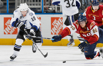 ATLANTA - OCTOBER 22:  Dominic Moore #19 of the Tampa Bay Lightning battles for the puck against Nik Antropov #80 of the Atlanta Thrashers at Philips Arena on October 22, 2010 in Atlanta, Georgia.  (Photo by Kevin C. Cox/Getty Images)