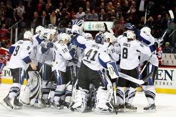 MONTREAL, CANADA - OCTOBER 13:  Members of the Tampa Bay Lightning celebrate the game winning goal by Ryan Malone #6 of the Tampa Bay Lightning during the NHL game against the Montreal Canadiens at the Bell Centre on October 13, 2010 in Montreal, Quebec,