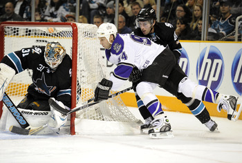 SAN JOSE, CA - DECEMBER 27: Ryan Smyth #94 of the Los Angeles Kings cant stuff the puck pass goalie Antti Niemi #31 of the San Jose Sharks during an NHL hockey game at the HP Pavilion on December 27, 2010 in San Jose, California. The Kings won the game 4-