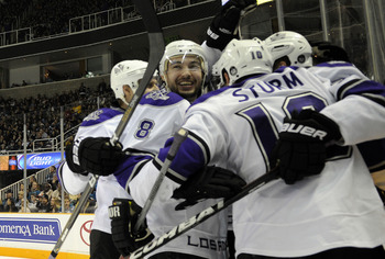 SAN JOSE, CA - DECEMBER 27: Drew Doughty #8 of the Los Angeles Kings celebrates with teammates after Dustin Brown #23 scores a goal against the San Jose Sharks during an NHL hockey game at the HP Pavilion on December 27, 2010 in San Jose, California. The