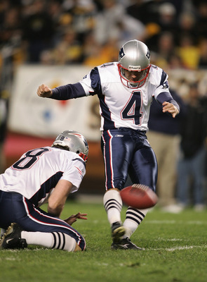 PITTSBURGH - OCTOBER 31:  Kicker Adam Vinatieri #4 of the New England Patriots attempts to score off a hold by punter Josh Miller #8 during the game against the Pittsburgh Steelers at Heinz Field on October 31, 2004 in Pittsburgh, Pennsylvania. The Steele