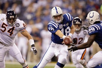INDIANAPOLIS - SEPTEMBER 07:  Quarterback Peyton Manning #18 of the Indianapolis Colts hands off the ball during their NFL game against the Chicago Bears at Lucas Oil Stadium on September 7, 2008 in Indianapolis, Indiana. The Bears defeated the Colts 29-1