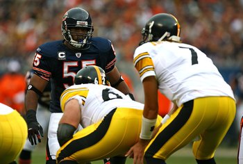 CHICAGO - SEPTEMBER 20: Lance Briggs #55 of the Chicago Bears stares at Ben Roethlisberger #7 of the Pittsburgh Steelers before the start of play on September 20, 2009 at Soldier Field in Chicago, Illinois. The Bears defeated the Steelers 17-14. (Photo by