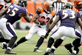 CINCINNATI - SEPTEMBER 19: Cedric Benson #32 of the Cincinnati Bengals carries the ball against Terrell Suggs #55 and Jameel McClain # 53 of the Baltimore Ravens at Paul Brown Stadium on September 19, 2010 in Cincinnati, Ohio.  The Bengals beat the Ravens