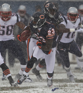 CHICAGO, IL - DECEMBER 12: Devin Hester #23 of the Chicago Bears runs after fielding a punt against the New England Patriots at Soldier Field on December 12, 2010 in Chicago, Illinois. The Patriots defeated the Bears 36-7. (Photo by Jonathan Daniel/Getty