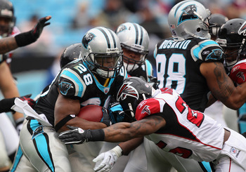 CHARLOTTE, NC - DECEMBER 12:  Jonathan Stewart #28 of the Carolina Panthers runs with the ball against the Atlanta Falcons during their game at Bank of America Stadium on December 12, 2010 in Charlotte, North Carolina.  (Photo by Streeter Lecka/Getty Imag