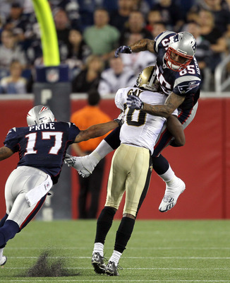 FOXBORO, MA - AUGUST 12: Randall Gay # 20 of the New Orleans Saints collides with Aaron Hernandez # 85 of the New England Patriots during the preseason game at Gillette Stadium on August 12, 2010 in Foxboro, Massachusetts. (Photo by Jim Rogash/Getty Image