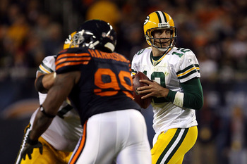 CHICAGO - SEPTEMBER 27:  Aaron Rodgers #12 of the Green Bay Packers drops back to pass against the Chicago Bears at Soldier Field on September 27, 2010 in Chicago, Illinois. The Bears won 20-17.  (Photo by Jonathan Daniel/Getty Images)