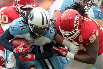 KANSAS CITY, MO - DECEMBER 26: Chris Johnson #28 of the Tennessee Titans carries the ball as Tyson Jackson #94 of the Kansas City Chiefs defends during the game on December 26, 2010 at Arrowhead Stadium in Kansas City, Missouri.  (Photo by Jamie Squire/Ge
