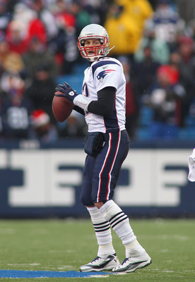 ORCHARD PARK, NY - DECEMBER 26:  Tom Brady #12 of the New England Patriots readies to throw a pass against the Buffalo Bills  at Ralph Wilson Stadium on December 26, 2010 in Orchard Park, New York.  New England won 34-3.  (Photo by Rick Stewart/Getty Imag