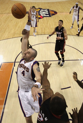 PHOENIX - DECEMBER 23:  Marcin Gortat #4 of the Phoenix Suns jumps for a rebound during the NBA game against the Miami Heat at US Airways Center on December 23, 2010 in Phoenix, Arizona. The Heat defeated the Suns 95-83.  NOTE TO USER: User expressly ackn