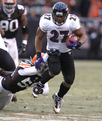 CLEVELAND - DECEMBER 26:  Running back Ray Rice #27 of the Baltimore Ravens runs by linebacker Eric Barton #50 of the Cleveland Browns at Cleveland Browns Stadium on December 26, 2010 in Cleveland, Ohio.  (Photo by Matt Sullivan/Getty Images)