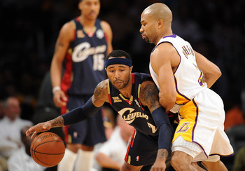 LOS ANGELES, CA - DECEMBER 25: Mo Williams #2 of the Cleveland Cavaliers drives against Derek Fisher #2 of the Los Angeles Lakers at Staples Center on December 25, 2009 in Los Angeles, California. NOTE TO USER: User expressly acknowledges and agrees that,