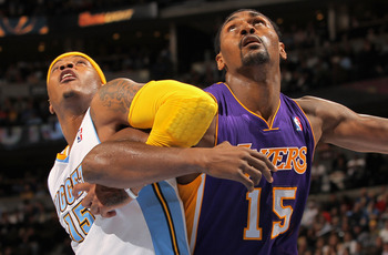DENVER - NOVEMBER 11:  Ron Artest #15 of the Los Angeles Lakers battles for position with Carmelo Anthony #15 of the Denver Nuggets at the Pepsi Center on November 11, 2010 in Denver, Colorado. The Nuggets defeated the Lakers 118-112.  NOTE TO USER: User