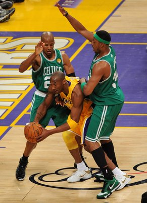 LOS ANGELES, CA - JUNE 17:  Kobe Bryant #24 of the Los Angeles Lakers looks to move the ball as he is double-teammed by Ray Allen #20 and Paul Pierce #34 of the Boston Celtics in Game Seven of the 2010 NBA Finals at Staples Center on June 17, 2010 in Los