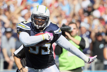 SAN DIEGO - OCTOBER 03:  Shaun Phillips #95 of the San Diego Chargers carries the ball following an interception against the Arizona Cardinals at Qualcomm Stadium on October 3, 2010 in San Diego, California.  (Photo by Jeff Gross/Getty Images)