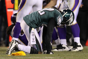 PHILADELPHIA, PA - DECEMBER 26:  Asante Samuel #22 of the Philadelphia Eagles kneels on the field after a flag was thrown on him for helmet to helmet contact against the Minnesota Vikings at Lincoln Financial Field on December 26, 2010 in Philadelphia, Pe