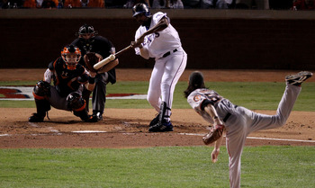 ARLINGTON, TX - NOVEMBER 01: Vladimir Guerrero #27 of the Texas Rangers hits a pop-fly out against starting pitcher Tim Lincecum #55 of the San Francisco Giants in the second inning of Game Five of the 2010 MLB World Series at Rangers Ballpark in Arlingto