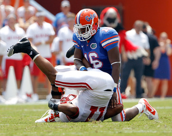 GAINESVILLE, FL - SEPTEMBER 04:  A.J. Jones #16 of the Florida Gators breaks up a pass to Armand Robinson #11 of the Miami University RedHawks at Ben Hill Griffin Stadium on September 4, 2010 in Gainesville, Florida.  (Photo by Sam Greenwood/Getty Images)