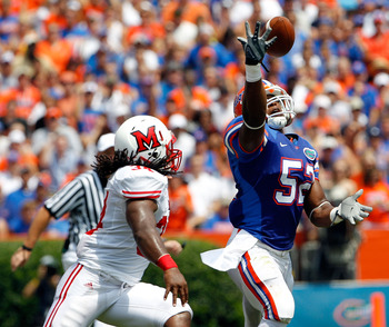 GAINESVILLE, FL - SEPTEMBER 04:  Jonathan Bostic #52 of the Florida Gators attempts an interception against the Miami University RedHawks at Ben Hill Griffin Stadium on September 4, 2010 in Gainesville, Florida.  (Photo by Sam Greenwood/Getty Images)