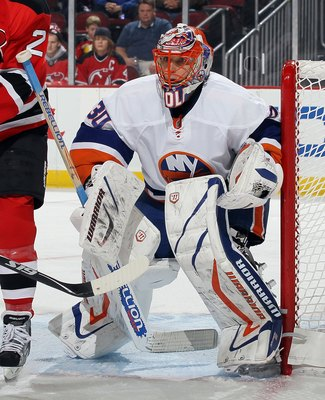 NEWARK, NJ - DECEMBER 23:  Dwayne Roloson #30 of the New York Islanders in action against the New Jersey Devils at the Prudential Center on December 23, 2010 in Newark, New Jersey.  (Photo by Jim McIsaac/Getty Images)
