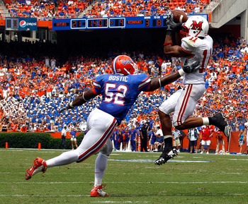 GAINESVILLE, FL - SEPTEMBER 04:  Armand Robinson #11 of Miami University RedHawks catches a pass against Jonathan Bostic #52 of the Florida Gators at Ben Hill Griffin Stadium on September 4, 2010 in Gainesville, Florida.  (Photo by Sam Greenwood/Getty Ima