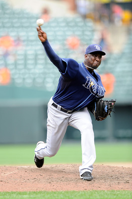 BALTIMORE - JULY 21:  Rafael Soriano #29 of the Tampa Bay Rays pitches against the Baltimore Orioles at Camden Yards on July 21, 2010 in Baltimore, Maryland.  (Photo by Greg Fiume/Getty Images)