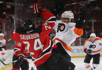 NEWARK, NJ - SEPTEMBER 28: Scott Hartnell #19 of the Philadelphia Flyers collides with Bryce Salvador #24 of the New Jersey Devils at the Prudential Center on September 28, 2010 in Newark, New Jersey.  (Photo by Bruce Bennett/Getty Images)
